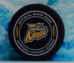 west_coast_authentic_whl_wheat_kings_unsigned_pucks