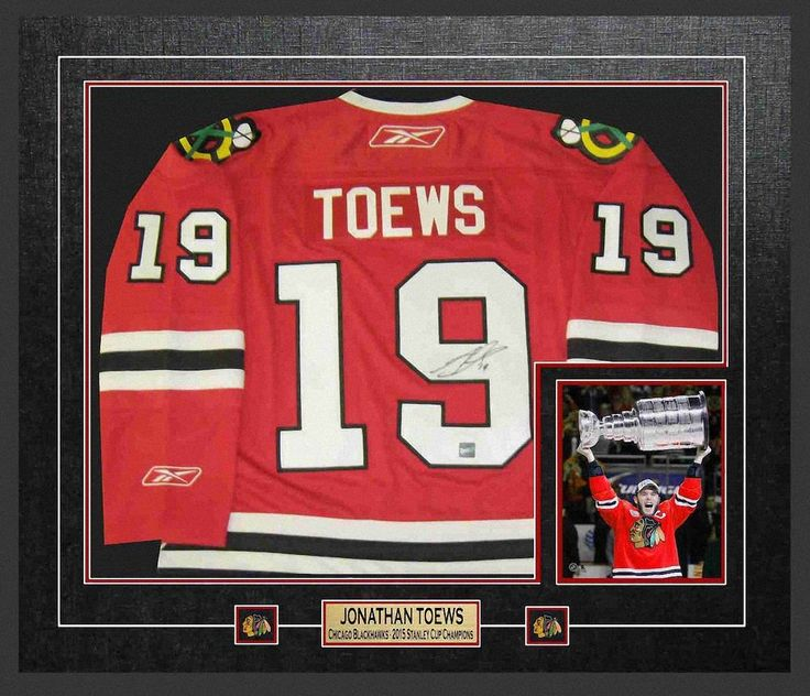 a5ccce5667d ... Autographed Jersey Framed Replica Blackhawks 2015 Stanley Cup  Champions.  West_Coast_Authentic_NHL_Blackhawks_Johnathan_Toews_Autographed_Framed_Jersey